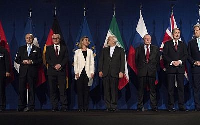From left, Head of Mission of the People's Republic of China to the European Union Hailong Wu, French Foreign Minister Laurent Fabius, German Foreign Minister Frank Walter Steinmeier, European Union High Representative Federica Mogherini, Iranian Foreign Minister Javad Zarifat, Russian Deputy Political Director Alexey Karpov, British Foreign Secretary Philip Hammond and US Secretary of State John Kerry arrive in Lausanne, Switzerland, Thursday, April 2, 2015, after the United States, Iran and five other world powers on Thursday announced an understanding outlining limits on Iran's nuclear program. (AP Photo/Brendan Smialowski, Pool)