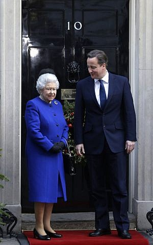 Prime Minister David Cameron greets Queen Elizabeth II at 10 Downing Street, Dec. 18, 2012. The Queen was visiting Downing Street to attend the cabinet as an observer. (photo credit: AP Photo/Lefteris Pitarakis)