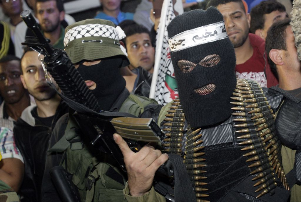 "Palestinian gunmen at a ceremony to mark the 12th anniversary of the Israeli army's ""Defensive Shield"" operation in the West Bank refugee camp of Jenin, Monday, April 7, 2014. (photo credit: AP Photo/Mohammed Ballas)"