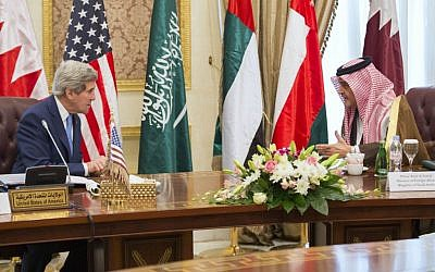 US Secretary of State John Kerry (left) talks with Saud bin Faisal bin Abdulaziz Al Saud (right), foreign minister of Saudi Arabia, during a meeting of Gulf foreign ministers at the Riyadh Air Base, Syria, March 5, 2015. (photo credit: AP/Evan Vucci)