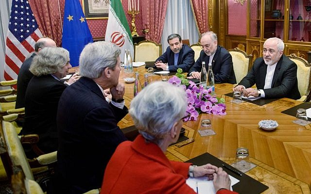 From left: Robert Malley, of the US National Security Council, US Secretary of Energy Ernest Moniz, US Secretary of State John Kerry, US Under Secretary for Political Affairs Wendy Sherman, Iranian Deputy Foreign Minister Abbas Araghchi, Head of Iranian Atomic Energy Organization Ali Akbar Salehi and Iranian Foreign Minister Mohammad Javad Zarif wait for a meeting, Friday, March 27, 2015 in Lausanne, Switzerland (photo credit: AP/Brendan Smialowski)