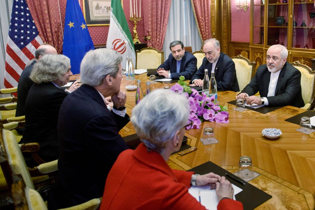 From left: Secretary of State John Kerry leads a US delegation across the table from Iranian Foreign Minister Mohammad Javad Zarif's negotiating team, March 27, 2015 in Lausanne (AP/Brendan Smialowski)