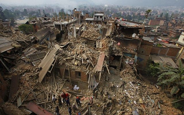 Rescue workers remove debris as they search for victims of the earthquake in Bhaktapur near Kathmandu, Nepal, April 26, 2015. (photo credit: AP/Niranjan Shrestha)