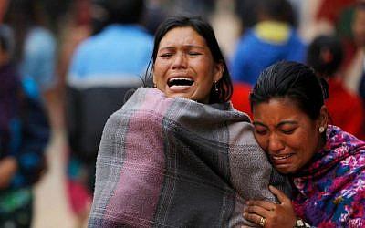 Family members break down during the cremation of an earthquake victim in Bhaktapur near Kathmandu, Nepal, Sunday, April 26, 2015. (AP Photo/Niranjan Shrestha)