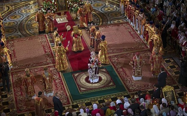 Russian Orthodox Patriarch Kirill, center, conducts the Easter service in Christ the Savior Cathedral in Moscow, Russia, April 12, 2015. (photo credit: AP/Alexander Zemlianichenko, Pool)