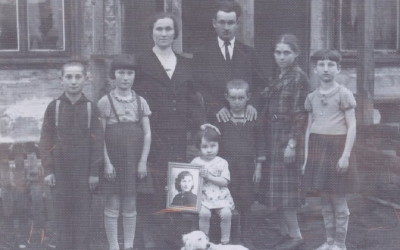 This undated photograph of the Achun family shows Yocheved holding a photograph of her Aunt Ruth, who was tormented by the presumed Holocaust deaths of these relatives. (Courtesy of Audrey Greenberg/JTA)