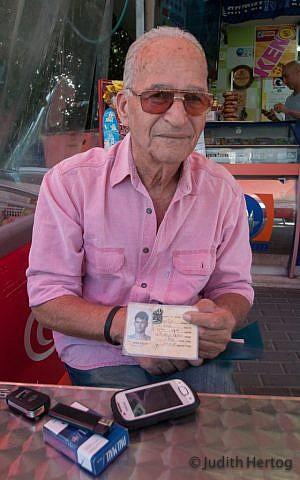 "Arieh Kalenski, 73, at the Mifgash Shiri lottery booth, on Brodetski Street in Tel Aviv, lives in Herzliya: ""...masochism is in human nature"" (Photo credit: Judith Hertog)"