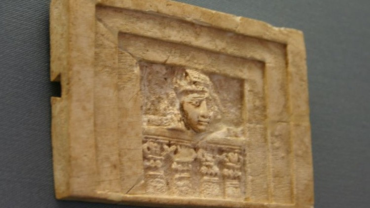 Window with a woman's disgusted face gazing outwards, at the Jerusalem Bible Lands Museum (photo credit: Shmuel Bar-Am)
