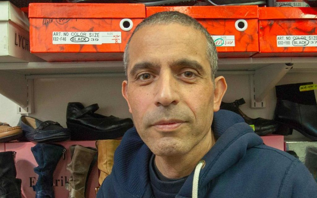 """Beni Bengi, 47, at Frederika Shoes, Sokolov Street, Herzliya, lives in Kfar Saba: """"I have already started over once, and I don't want to do it again."""" (Photo credit: Judith Hertog)"""