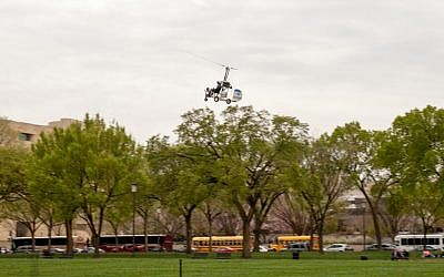 A small helicopter lands on the West Lawn of the Capitol in Washington, Wednesday, April 15, 2015.  (photo credit: Sam Smith/AP)