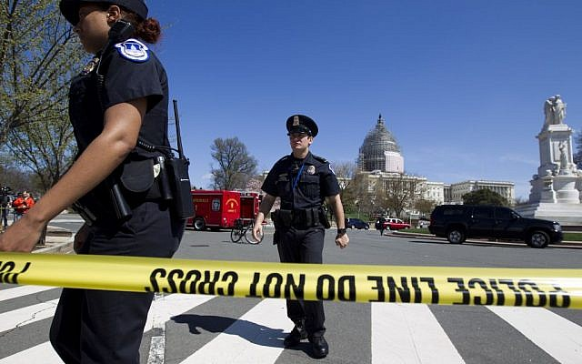 Police officers at the US Capitol in Washington, Saturday, April 11, 2015. (photo credit: AP Photo/Jose Luis Magana)