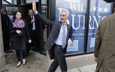 "Chicago Mayor Rahm Emanuel waves to supporters as he leaves a campaign office Tuesday, April 7, 2015 in Chicago, as he and his opponent, Cook County Commissioner Jesus ""Chuy"" Garcia, rally supporters on the morning of the city's mayoral runoff election. (Photo credit: AP/M. Spencer Green)"