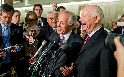 Senate Foreign Relations Committee Chairman Sen. Bob Corker and Sen. Ben Cardin speak to reporters on Capitol Hill, Washington, April 14, 2015. (photo credit: AP/Andrew Harnik, File)
