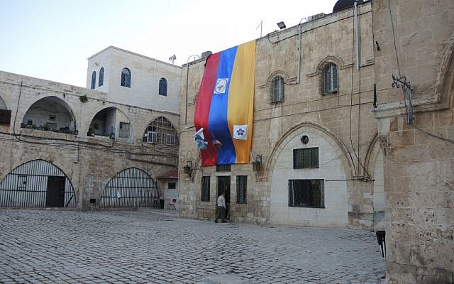 A giant flag hangs in the Armenian Quarter ahead of 100th anniversary commemorations in Jerusalem's Old City.  (Melanie Lidman/Times of Israel)