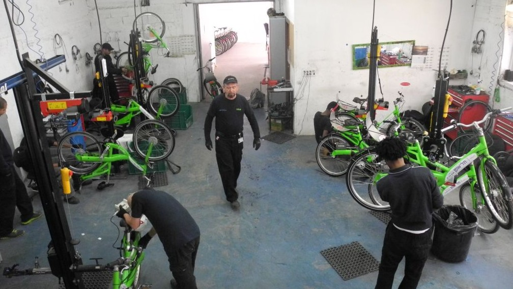 Ten mechanics try to give each bike a tune-up at least once a month. Flat tires account for 50 percent of the work, leading the company to experiment with airless tires. (photo credit: Melanie Lidman/Times of Israel)