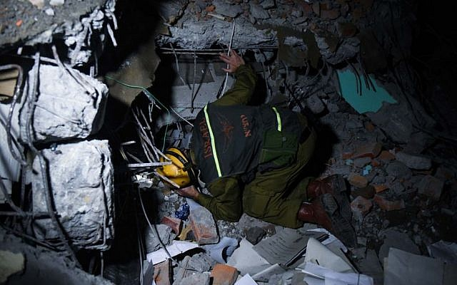 Members of the IDF search and rescue team canvas collapsed buildings to search for survivors in Kathmandu on Tuesday. (photo courtesy: IDF Spokesperson)