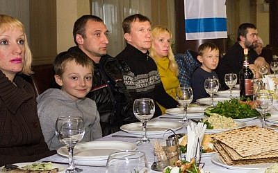 Jewish refugees from eastern Ukraine celebrate a simulated Passover 'seder' meal at The Jewish Agency's refugee center outside Dnipropetrovsk ahead of their immigration to Israel, March 29, 2015. (photo credit: The Jewish Agency/Vlad Tomilov)