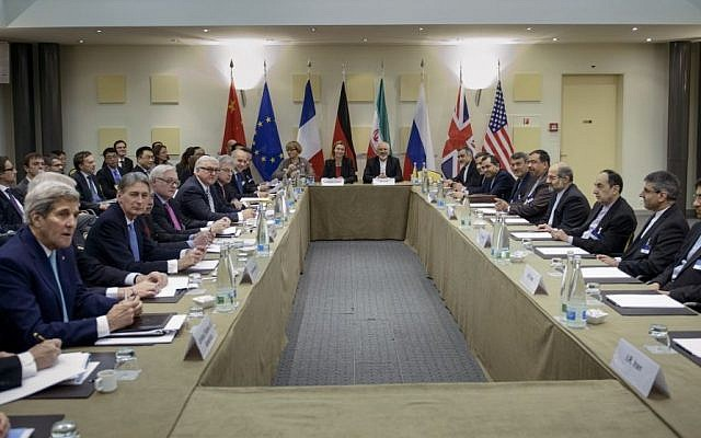 Iranian Foreign Minister Javad Zarif, center right, European Union High Representative Federica Mogherini, center left, and other officials from Britain, China, France, Germany, Russia and the United States wait for the start of a meeting on Iran's nuclear program at the Beau Rivage Palace Hotel in Lausanne, Switzerland Tuesday, March 31, 2015. (photo credit: AP/Brendan Smialowski, Pool)