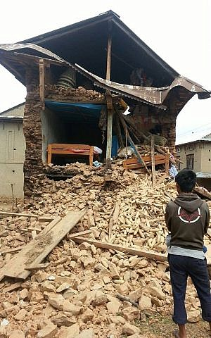 A house damaged in the earthquake that ravaged Nepal in the village of Manegau where Israeli volunteers are working with Tevel B'Tzedek.  (photo courtesy Tevel B'Tzedek)