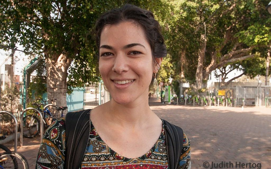 """Alumah L., 24, on the 480 bus from Jerusalem to Tel Aviv, lives in Jerusalem: When you read an ancient text, it actually talks to you."""" (Photo credit: Judith Hertog)"""