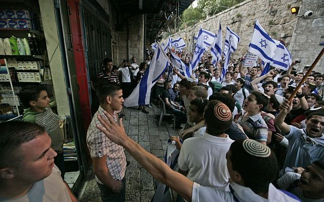 Israeli youth chant outside an Arab store in the Old City during Jerusalem Day's 'flag march,' May 21, 2009. (photo credit: Abir Sultan/Flash90)