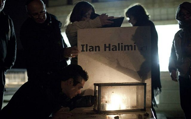 Family and friends attend a memorial ceremony by the grave of 23-year-old Ilan Halimi, at the Givat Shaul cemetery in Jerusalem. February 13, 2013. Photo by Tali Mayer/FLASH90