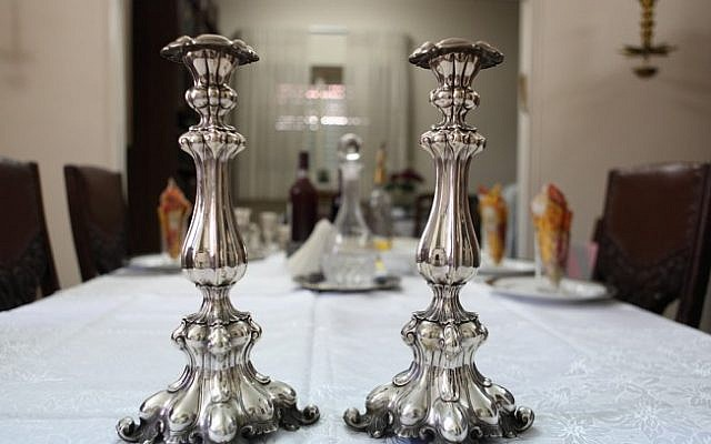 Illustrative. Shabbat candlesticks. (Yaakov Naumi/Flash90)