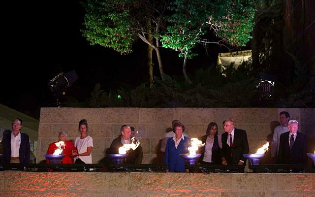 Illustrative: Survivors, some accompanied by their children or grandchildren, light six torches at Yad Vashem on the eve of Holocaust Remembrance Day in 2017. (Yonatan Sindel/ Flash 90)