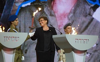 Miriam Peretz, the bereaved mother of two Israeli soldiers, holds a torch during the Israeli 66th Independence Day Ceremony at Mount Herzl in Jerusalem on May 5, 2014. (Yonatan Sindel/Flash90