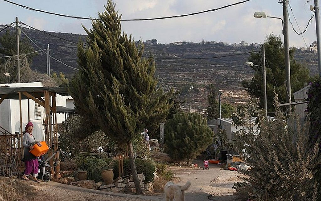 Illustrative photo: A settler walking near her house in the Jewish settlement of Bat Ayin in the West Bank on September 15, 2014. (Photo credit: Nati Shohat/Flash90)