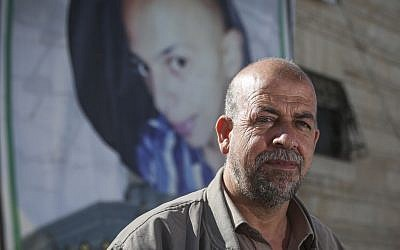 Hussein Abu Khdeir, the father of the slain Palestinian teen Muhammed Abu Khdeir, outside his home in East Jerusalem, October 21, 2014 (photo credit: Hadas Parush/Flash90)