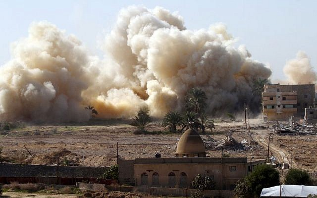 Smoke rises after a house was blown up during a military operation by Egyptian security forces in the Egyptian city of Rafah near the border with southern Gaza Strip on November 20, 2014 (photo credit: Abed Rahim Khatib/Flash90)