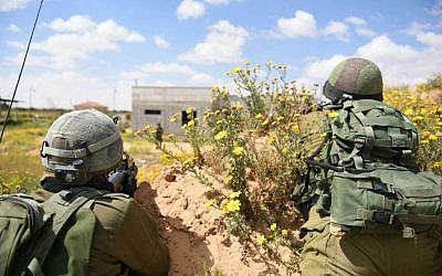 Soldiers practice in an IDF drill in the Gaza border Division on March 22, 2015. The drill was meant to reenact scenarios following lessons learnt from last summer's Operation Protective Edge (photo credit: IDF spokesman)