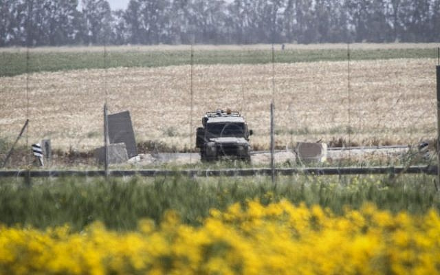 An Israeli military vehicle on standby near the border between Israel and the Gaza Strip on March 30, 2015 (Abed Rahim Khatib/Flash90)