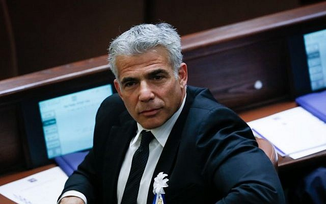 Leader of the Yesh Atid party, MK Yair Lapid, seen at the swearing-in ceremony for the 20th Knesset, at the Israeli parliament in Jerusalem, on March 31, 2015. (photo credit: Miriam Alster/Flash90)