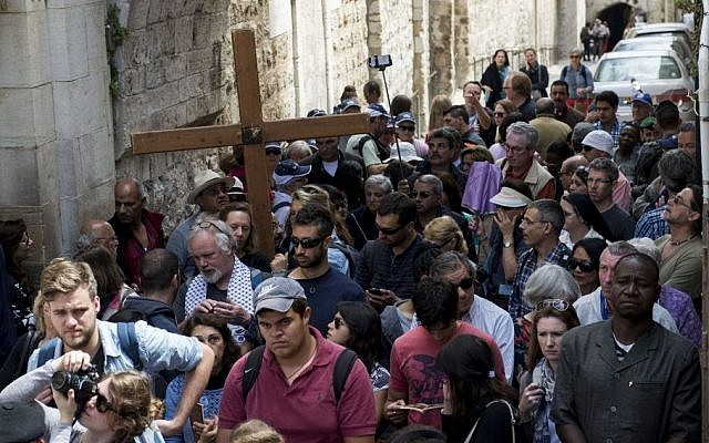 Christian Catholic worshipers hold crosses as they take part in a Good Friday procession, during the holiday of Easter, on the Via Dolorsa in Jerusalem's Old City on April 03, 2015. (photo credit: Danielle Shitrit/Flash90)