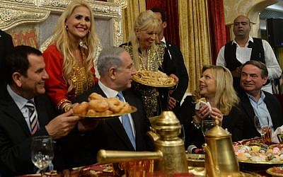 Prime Minister Benjamin Netanyahu and his wife Sara attend a Mimouna celebration in Or Akiva on April 11, 2015. (Kobi Gideon / GPO)