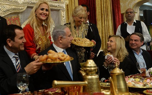 Prime Minister Benjamin Netanyahu and his wife Sara attend a Mimouna celebration in Or Akiva on April 11, 2015. (Kobi Gideon / GPO)