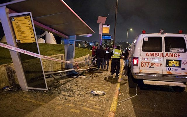 The aftermath of an alleged car-ramming attack that killed Shalom Sherki and injured Shira Klein at the French Hill junction in Jerusalem on April 15, 2015 (photo credit: Yonatan Sindel/Flash90)