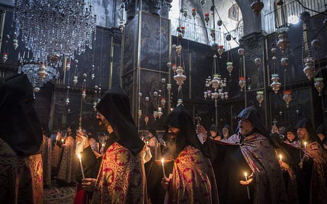 .Armenian priests hold Easter Sunday prayers at the Saint James Armenian Church in the Armenian Quarter of Jerusalem's Old City, on April 12, 2015. (Hadas Parush/Flash90)