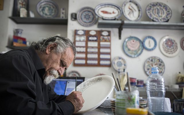 Hagop Antreassian works in his studio for traditional Armenian art, in the Armenian Quarter of Jerusalem's Old City, on April 18, 2015. Hagop's father is a genocide survivor who escaped the massacres in Turkey at the age of 7 and made his way walking through the desert to Jerusalem. This year, on April 24, the Armenians will mark the 100th anniversary of the Armenian Genocide. (photo credit: Hadas Parush/Flash90)