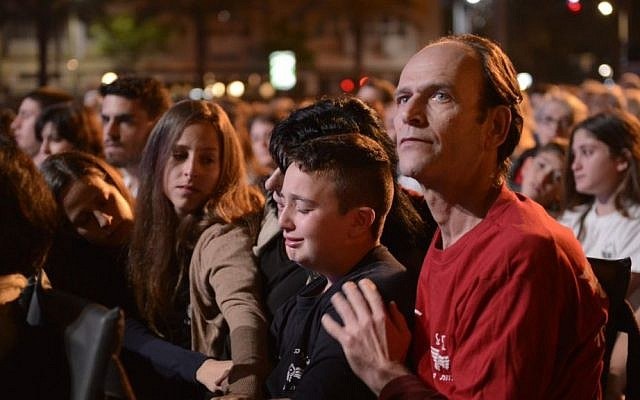 Friends and family of IDF soldier Roy Peles, who was killed last summer in combat in the Gaza Strip during Operation Protective Edge attend a Memorial Day event at Rabin square in Tel Aviv, April 21, 2015. (Danielle Shitrit/Flash90)