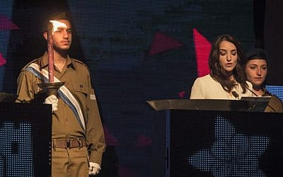 Arab Israeli journalist Lucy Aharish lights a ceremonial torch during the Israeli 67th Independence Day Ceremony at Mount Herzl in Jerusalem on April 22, 2015. (Photo credit: Hadas Parush/Flash 90)