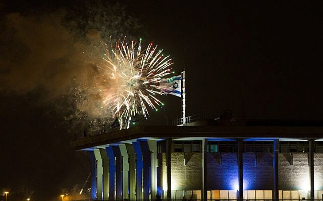 Fireworks from the Mount Herzl ceremony seen over the Knesset in Jerusalem, marking the beginning of the celebrations of Israel's 67th Independence Day, on April 22, 2015. (photo credit: Yonatan Sindel/Flash90)