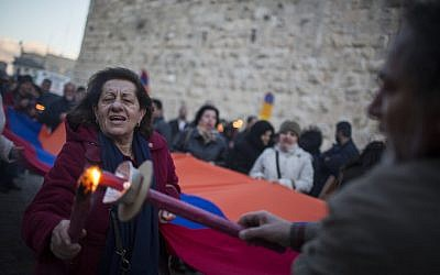 Armenians march with Armenian flags, signs, and torches from the Armenian Quarter of Old City to the Armenian Church in the German Colony, Jerusalem, as they mark the 100th anniversary of the Armenian Genocide, on April 23, 2015 (photo credit: Hadas Parush/Flash90)