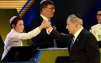 Eyal Matas, the winner of the annual Bible Quiz held at the Jerusalem Theater on Israel's Independence Day, receives his award from Prime Minister Benjamin Netanyahu on April 23, 2015. (photo credit: Haim Zach / GPO)