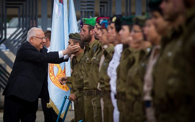 Israeli President Reuven Rivlin jokes with soldiers as he inspects the ranks during a ceremony for outstanding servicemen as part of Israel's 67th Independence Day celebrations on April 23, 2015 at the President's residence in Jerusalem. (Photo credit: Miriam Alster / Flash90)