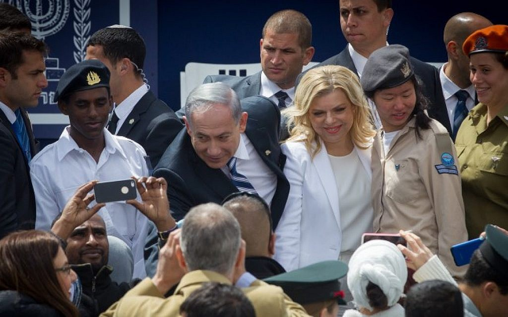 Prime minister Benjamin Netanyahu and his wife Sara are greeted by Israeli soldiers at a ceremony for outstanding soldiers as part of Israel's 67th Independence Day celebrations, at the President's residence in Jerusalem. April 23, 2015 (Photo credit: Miriam Alster/Flash90)