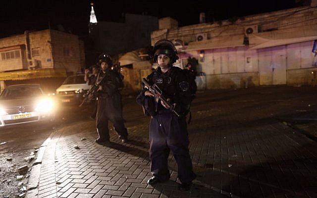 Israeli Police at the scene where several policemen were run over by an alleged drive-by terrorist near the Arab neighborhood of A-Tur in East Jerusalem, on April 25, 2015. (Photo credit: Yonatan Sindel/Flash90)