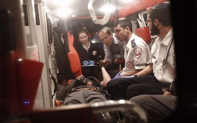 Jerusalem Mayor Nir Barkat seen inside an ambulance evacuating a wounded police officer from the scene where a Palestinian driver ran over several police men and women near the Arab neighborhood of A-Tur in East Jerusalem, on April 25, 2015. Photo by Yonatan Sindel/Flash90
